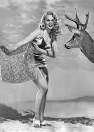 Adele Jergens - Posing with Deer Photo Print (8 x 10) - Item # DAP135 -  Posterazzi