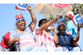 Oh snap! A photo review of 2017 by the Observer's photographers - July:  Ossie Cassell, Ida Jordan and their mother, Luella Johnson, sit on a  history of Flagler County float during the