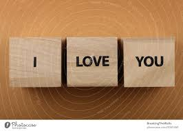wooden cubes with i love you words over
