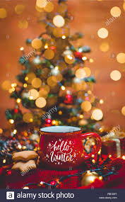 red mug of hot coffee christmas lights fresh cookies and