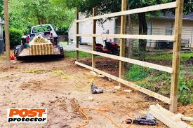 Fence Posts With Post Protector S Barrier Protection To Stop Post Decay And Insect Infestation Barrier Protection Fence Post Installation Fence Post