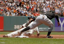 Nori Aoki of the San Francisco Giants is tagged out by Josh ...
