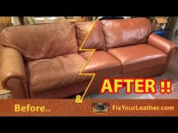 old faded worn leather couch