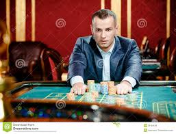 Gambler Stakes Playing Roulette At The Casino Stock Image - Image ...