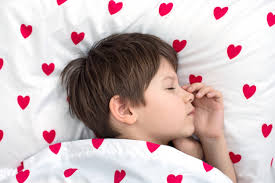sleeping soundly on white bedding