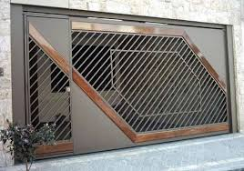 Breaking News Americans Have Like Totally Lame Garage Doors Brazilians On The Other Hand Have A Garage Door Design Entrance Gates Design Main Gate Design