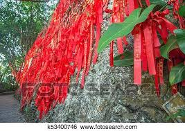Tall Trees Is Completely Decorated With Red Ribbons Many Red Ribbons Tied To Trees Asia Stock Photograph K53400746 Fotosearch