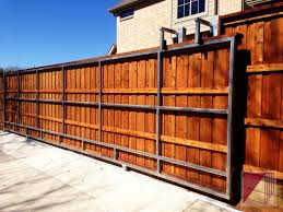 A Very Long Wooden Slide Gate Wood Fence Gates Fence Gate Wooden Gates Driveway