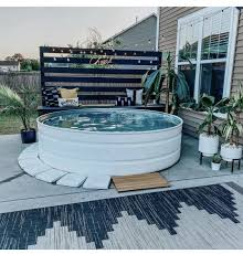 Pin by Ada Simmons on Stock tank swimming pool in 2020   Small backyard  pools, Backyard inspiration, Outdoor backyard