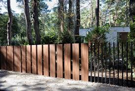 This New Fancy Fence System Retracts Gate Directly Into Ground Archdaily