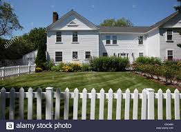 White Clapboard House And White Picket Fence In Hyannis On Cape Cod Stock Photo Alamy