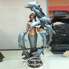 mermaid garden statue outside boy