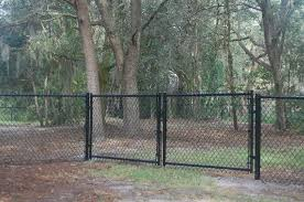 Black Coated Chain Link Driveway Gate Driveway Gate Types Of Fences Gate