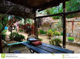 Wooden Veranda With Table And Chairs In A Garden Stock Photo ...