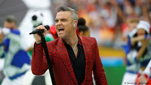 Did Robbie Williams ′sell his soul′ to Putin? | Music | DW | 14.06 ...