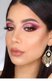 glam makeup with gold earrings
