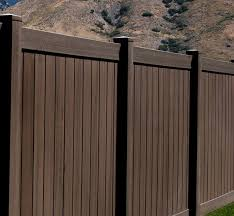 Colored Vinyl Fencing And What It Means For You Wood Grain Vinyl Fence Vinyl Fence Colors Vinyl Fence