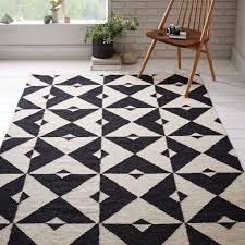white geometric pattern dhurrie rug