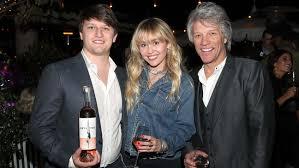 Miley Cyrus, Dakota Fanning Toast to Jon Bon Jovi and His Son ...