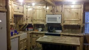 handmade rustic log kitchen cabinets