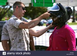 Staff Sgt. Dustin Cutsinger fits Chrystal Smith with protective ...