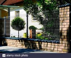Metal Fence Detail With Galvanized Wire Mesh Panels House Exterior Background With Beautiful Front Yard Shrub And Evergreen Tree Home Ownership Stock Photo Alamy