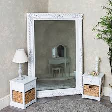 large white wall floor leaner mirror