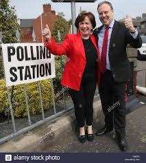 Sitting MEP Diane Dodds, with husband Nigel Dodds, arrives at Bannside  Presbyterian Church in Banbridge to cast her vote for the European  Parliament election Stock Photo - Alamy