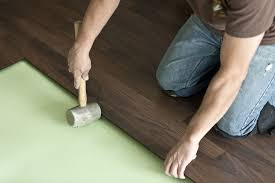 can you add padding under a wood floor