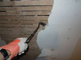 removing plaster from the wall ceiling