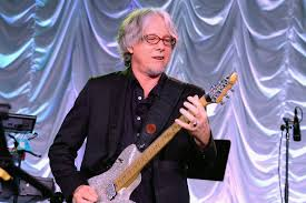 R.E.M.'s Mike Mills Discusses Singles, Bass Lines + More