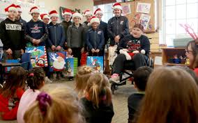 Local woman enlists youth hockey players to make tie-blanket gifts ...