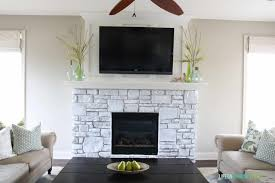 simplicity white washed stone fireplace