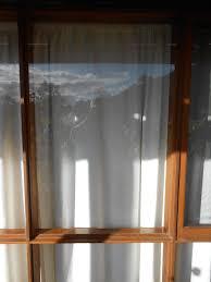 glass in a wood frame window