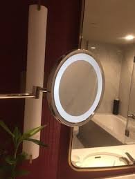 a lighted vanity mirror with an