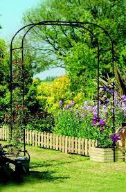 diy garden ideas garden arch and bench