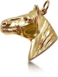 a 14k retro yellow gold horse