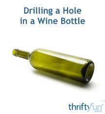 drilling a hole in a wine bottle