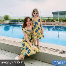 Mã NOWSHIPVUI2 giảm 25k đơn 50k] Váy đôi hoa vàng mẹ và bé gái, đồ ...
