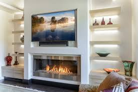 install a tv over a fireplace