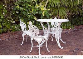 chairs on brick white wrought iron