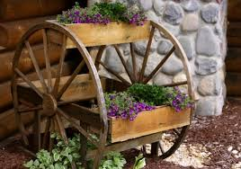 Recycling Antique Wheels For Unique Garden Decorations In Vintage Style