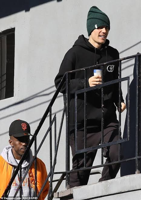 Image result for Justin Bieber practices his dance moves outside a studio... after ex Selena Gomez releases her album Rare that seems to trash him""
