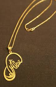 personalized gold pendant that has a