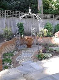 fire pit wrought iron arbour and black