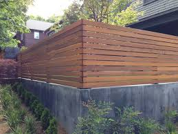 Landscape Retaining Walls With Fences Installed Ontop Google Search Wood Fence Design Modern Fence Design Backyard Fences