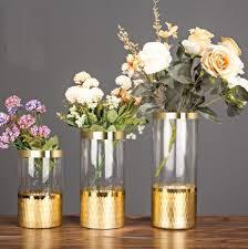 engraved glass vase with goldleaf hand