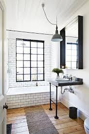 rustic full bathroom with pendant light