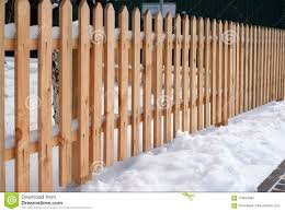 Wooden Fence Covered With Snow Around Garden In Winter Time Stock Photo Image Of Design Wooden 110634062