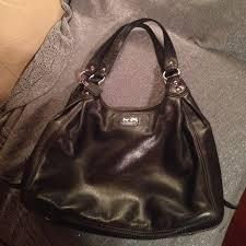 black purse with purple lining